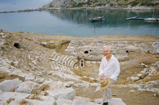 "Roger soaking up inspiration at ancient Knidos in Turkey, once home of Aphrodite of Knidos, a most famous sculpture in antiquity.  Aphrodite and another statue, The Lion of Knidos, make their way into Roger's original music in Reflections In The Wine Dark Sea.""  2012 photo courtesy of Roger Latzgo."